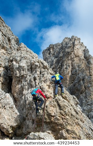 mountain guide in the dolomites - portrait format - The Dolomites - UNESCO World Heritage - stock photo