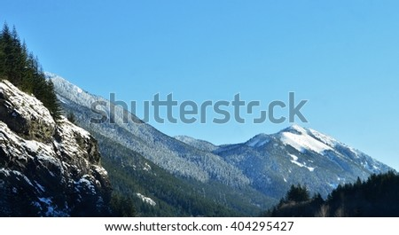 Mountain hillside on a sunny winter day - stock photo
