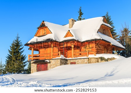 Mountain house covered with fresh snow in Gorce Mountains in winter season, Poland - stock photo