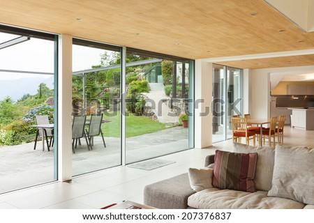 mountain house, modern architecture, interior, living room, veranda view - stock photo