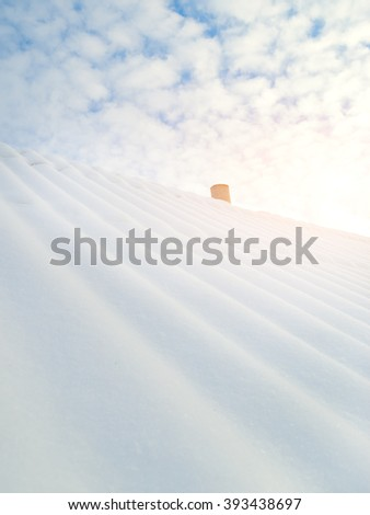 mountain house roofs covered by snow - stock photo