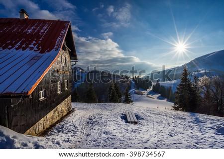Mountain hut in Velka Fatra mountains, Slovakia winter trip - stock photo