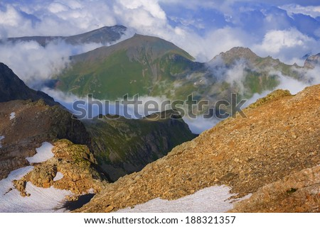 mountain in a dense clouds - stock photo
