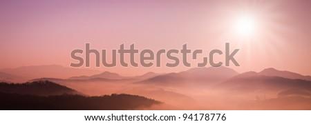 Mountain in fog - stock photo