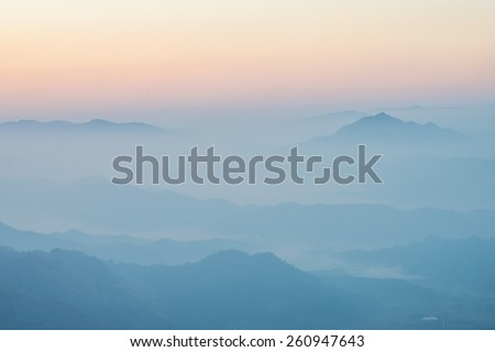 Mountain in the mist layer background - stock photo