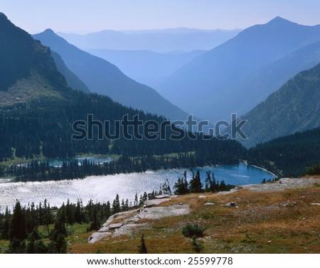 Mountain Lake And Alpine Peaks, Glacier National Park, Montana - stock photo