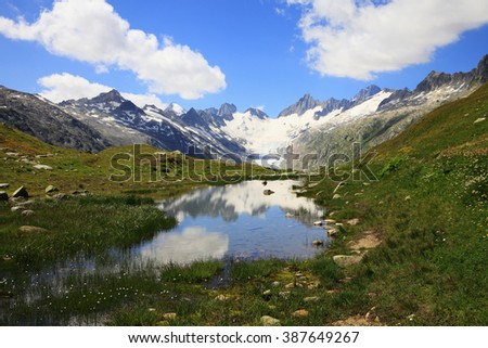Mountain lake and mountain of Oberaarhorn in the swiss alps  - stock photo