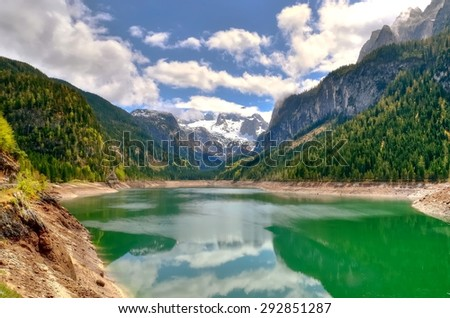 Mountain lake in Austrian Alps. View of Hoher Dachstein and Mitterspitz from the lake Vorderer Gosausee in Austria. - stock photo