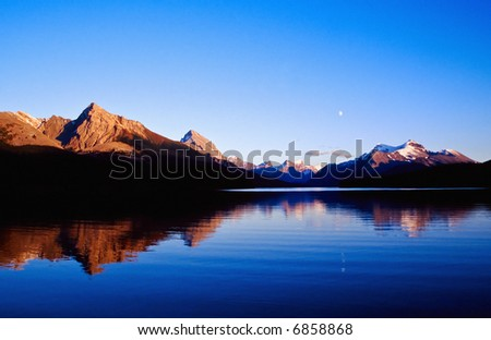 Mountain Lake in moonlight - stock photo
