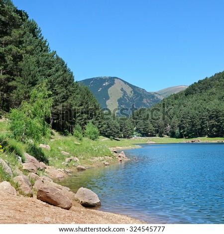 mountain lake in the Pyrenees (Andorra) - stock photo