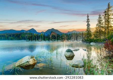 Mountain lake Strbske pleso in National Park High Tatra covered by the morning fog, Slovakia, Europe - stock photo