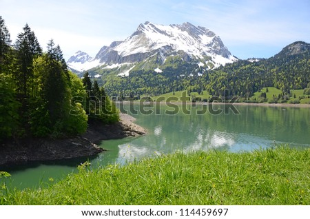 Mountain lake. Switzerland - stock photo