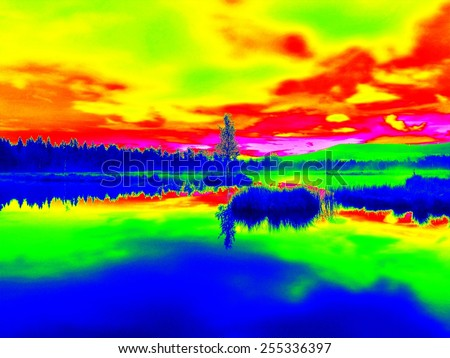 Mountain lake with small island  in middle. Cloudy sky in mirror of water level, strange colors of thermography photo.  - stock photo