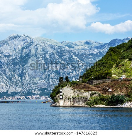 Mountain landscape and old lighthouse in Kotor bay, Montenegro. - stock photo