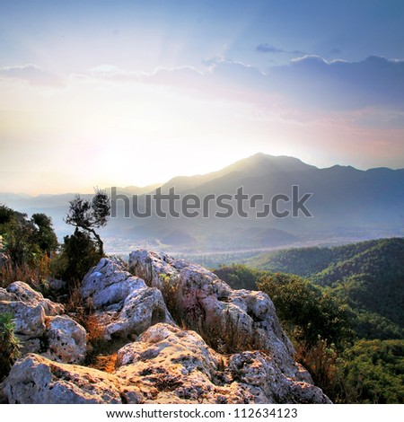 Mountain landscape at sunrise. Silhouette. - stock photo