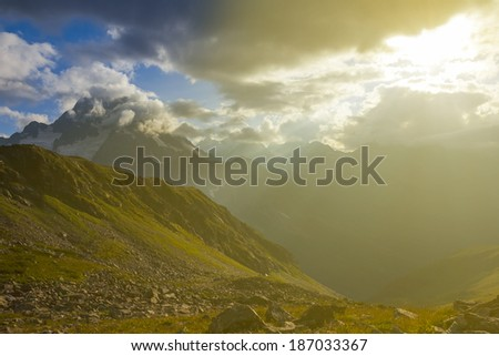 mountain landscape by a sunny day - stock photo