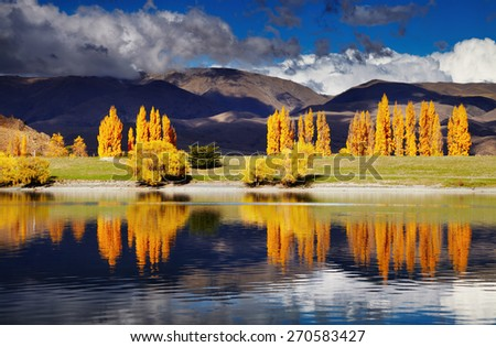 Mountain landscape in autumn colors, Lake Benmore, New Zealand - stock photo