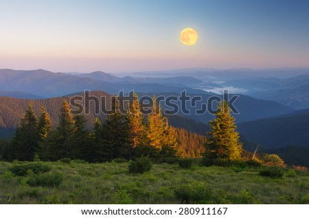Mountain landscape. Morning light. The full moon. Beauty in nature - stock photo