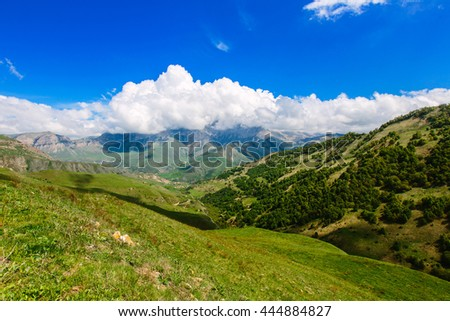 Mountain landscape. Mountain Ridge rushes into the distance and the low-hanging clouds. The Caucasus  - stock photo