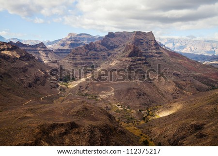 Mountain landscape on Gran Canaria island (Spain), between Maspalomas and San Bartolom���© de Tirajana (coordinates 27.81304,-15.582028) - stock photo