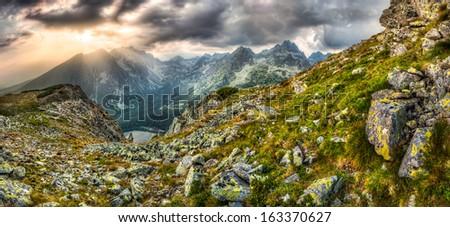 mountain landscape panorama with Poprad Pond at sunset, High Tatras, Slovakia - stock photo
