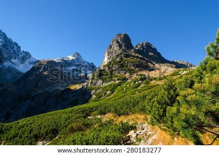 Mountain landscape. Picturesque view over trail and high peaks in Tatra mountains in autumn season. - stock photo