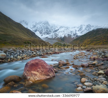 Mountain landscape. River Valley. The highest mountain of Georgia - Shkhara. Main Caucasian ridge. Zemo Svaneti, Georgia  - stock photo