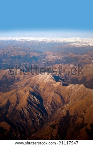 Mountain landscape seen from above, with some snow - stock photo
