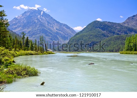Mountain landscape with a calm river - stock photo