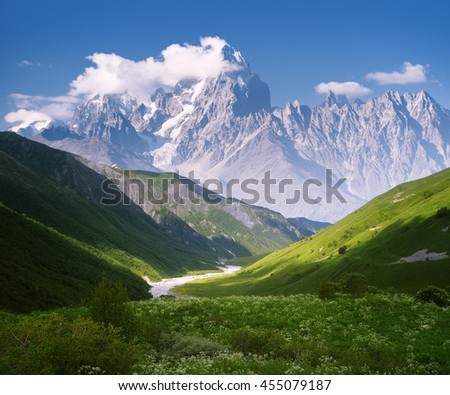 Mountain landscape with a river. Sunny summer day. Slopes with green grass and beautiful valley. Blue sky and the top of the clouds. Collage of two frames - stock photo