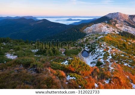 Mountain landscape with a small lake. Sunny autumn morning. Carpathians, Ukraine, Europe - stock photo