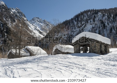 mountain landscape with old stone houses uninhabited - stock photo