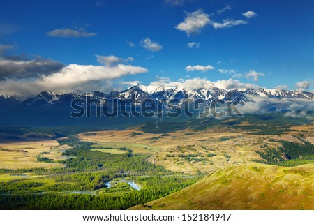 Mountain landscape with river and snowy peaks - stock photo