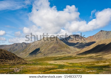 Mountain landscape with sky and clouds, Ural Mountains, Russia. - stock photo