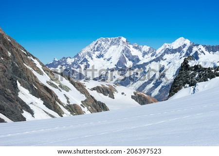 Mountain landscape with snow and clear blue sky - stock photo