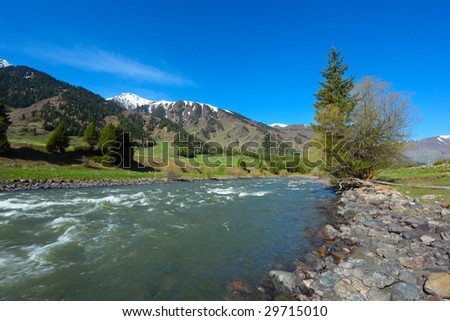 Mountain landscape with the river - stock photo