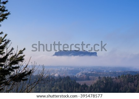 Mountain Lilienstein in the fog - stock photo