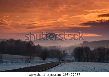 Mountain Lilienstein in the morning fog - stock photo