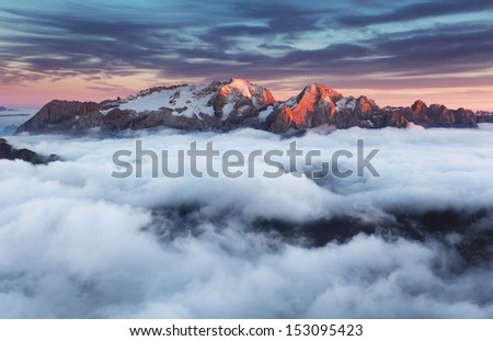 Mountain Marmolada at sunset in Italy dolomites at summer - stock photo