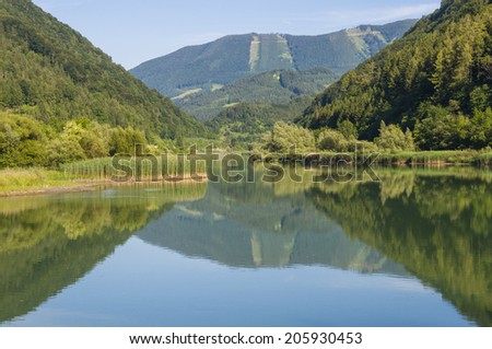 Mountain mirroring in the river Enns. The Enns valley is located in Upper Austria. The Hintergebirge ore Lime Stone Alps. is the largest closed and virtually uninhabited forest area in Austria - stock photo