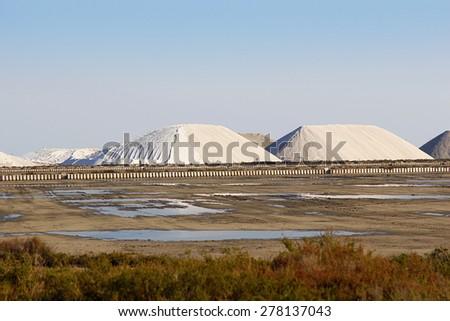 Mountain of sea salt in a salt extraction undertaking - stock photo