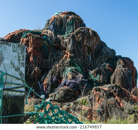 Mountain of used fishing nets - stock photo