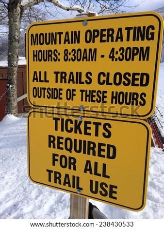 Mountain operating sign at ski resort - stock photo