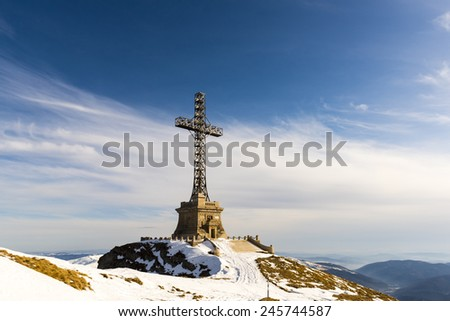 Mountain panorama with a giant cross. - stock photo