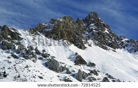 Mountain peak view with snow - stock photo