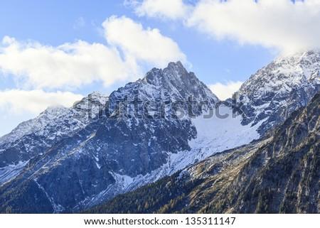 Mountain peak with snow in alps - stock photo