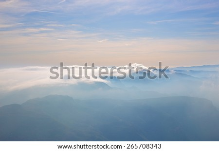 Mountain peaks covered by clouds, Montserratt, Spain - stock photo