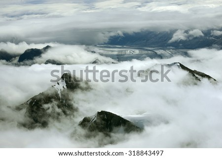 Mountain Peaks in Clouds and Glacier, Kluane National Park, Yukon - stock photo