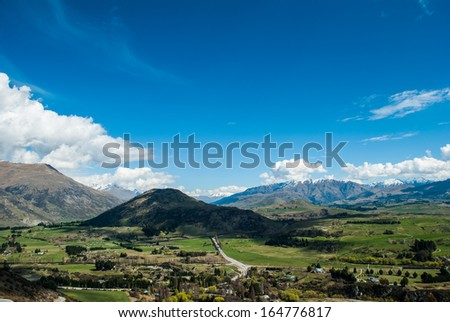 Mountain Peaks with Snow Meadow, New Zealand - stock photo