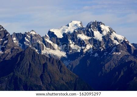 Mountain Peaks with Snow, New Zealand - stock photo